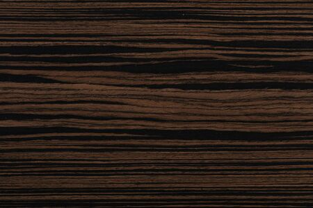 Unique ebony veneer background in dark color. Reklamní fotografie
