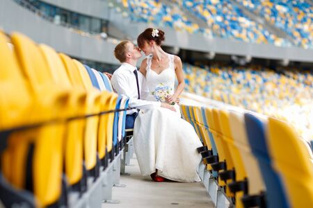Sweet couple bride and groom on a perfect ukrainian stadium.