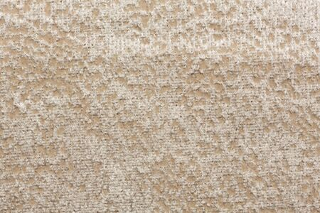 Unusual impressively beige textile background. High resolution photo.