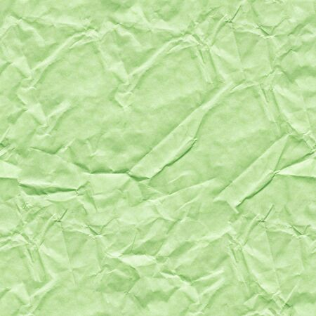 Crumpled paper background in gentle light green color for your greeting card. Seamless texture. Stock fotó