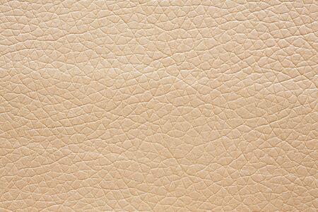 Leatherette background in gentle beige colour. Stock fotó