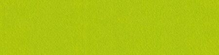 Lime felt fabric close-up. Panoramic seamless texture, pattern f Standard-Bild