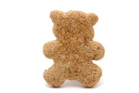 bear shaped gingerbread cookie on white