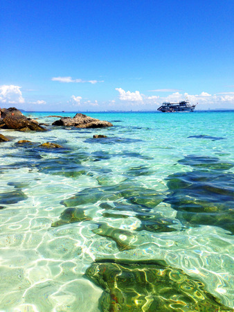 clear water: Sea, light-blue bank, clear water, clean water, ship, stones, ocean, blue sky, summer, sun Stock Photo