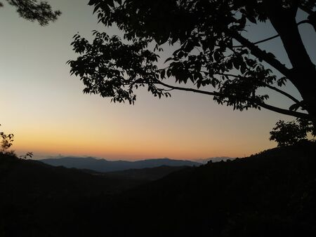 Amazing evening dark sunset landscape with a tree in right side of photo in tourism of north India