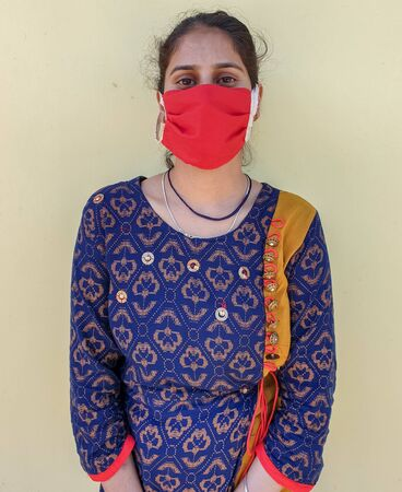 Photo of a young indian girl wearing face mask for prevention from coronavirus during lockdown with selective focus, selective focus on subject, background blur