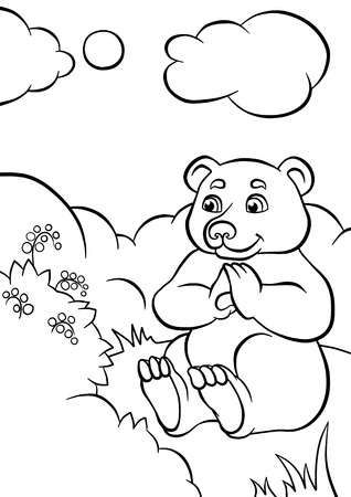 bear berry: Cute bear sitting and looking at berry in the forest. He is smiling.