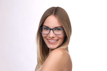 pretty blond woman with glasses smiles Stock Photo