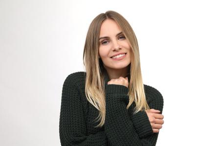 beautiful woman in knit sweater smiles