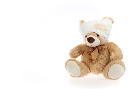 Injured teddy bear with bandage around his head Stock fotó