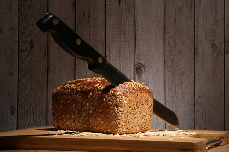 Loaf of bread with a knife stuck in it