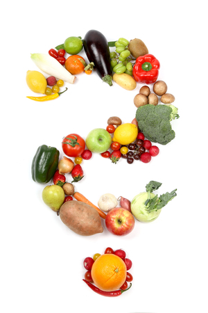 Different types of vegetables and fruits forming a question mark