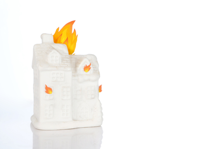 White model of a house that burns