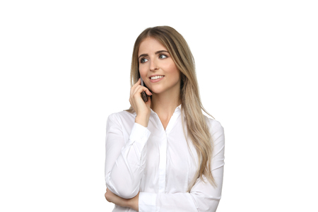 Pretty blond woman telephones Stock Photo