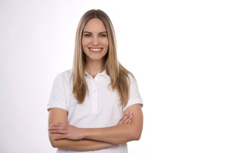 Pretty girl with blond hair wears a polo shirt and crosses on her arm