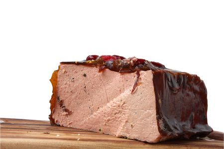 foie gras: P�t� de foie gras with a black truffle and cranberries on cutting board