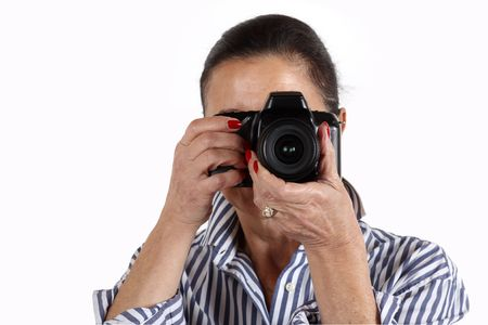 woman has fun taking pictures with her digital camera photo