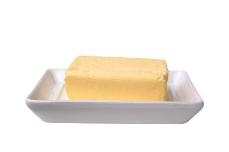 Bloque de mantequilla en una butterdish Foto de archivo