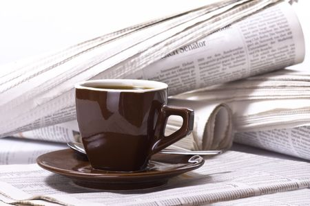 exceeds: Pot of Coffee on newspaper background, business
