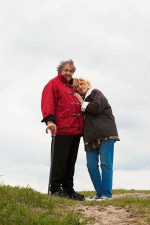 Senior woman hugging her husband isolated on white photo