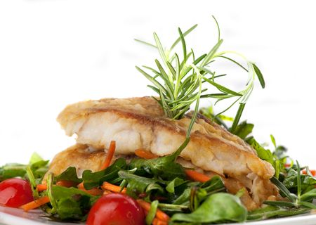 seared: pan seared fillet of white fish and vegetables on white background