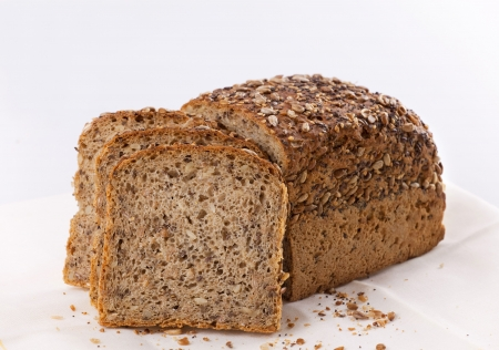 Sliced homemade brown bread with cereals Stock Photo