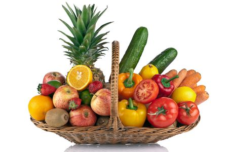 colorful fruit and vegetables  composition on the Basket isolated on white photo