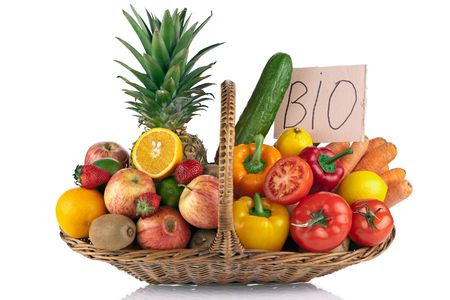 Fresh fruit and Vegetables in the basket against a white background photo
