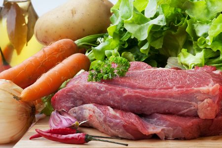 butchered: fresh beef on board ready to cook with Ingredient