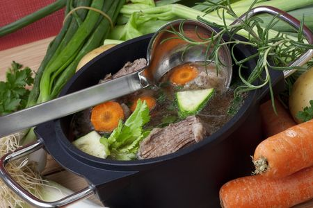 Beef boiled in pan with carrot, leeks, celery and spices for beef soup, ready to serve. Stock Photo - 7034948
