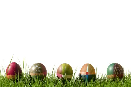 Colorful Hand painted Easter eggs with spots and stripes on grass  Stock Photo