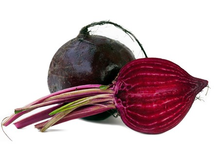 Beet purple vegetable with light shadow on white background