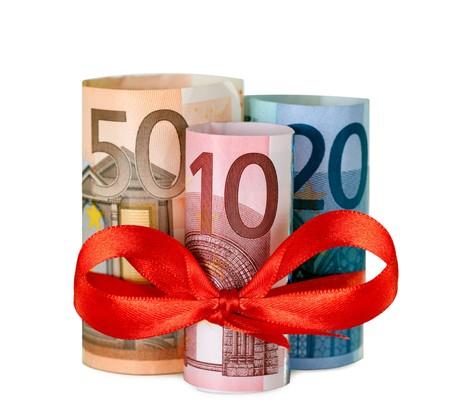 achtzig: Aufgerollt achtzig Euro with Red Ribbon isolated on white background Lizenzfreie Bilder