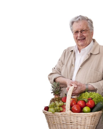 Healthy senior man with Vegetable shopping bag. Isolated on white.  photo