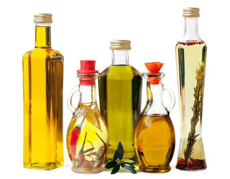 Different sorts of cooking oil isolated on white background  Stock Photo