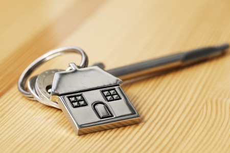 House key on wooden surface Stock Photo - 7925663