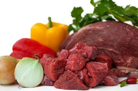 Chunks of lean beef, ready for making beef stew or hearty chili or Goulash with Ingredient. Isolated on white.