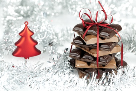 wintery: Christmas chocolate stack present on a fluffy background Wintery Decoration