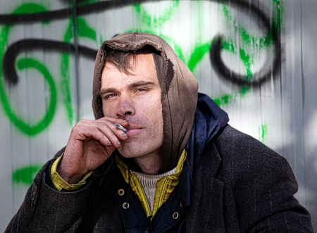 only mid adult men: Homeless Men Being Friendly smokes a cigarette Outdoor