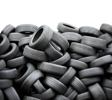 Wall of old car tires on white background photo