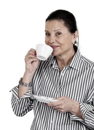 Happy stirring her morning-coffee or tea against white background photo