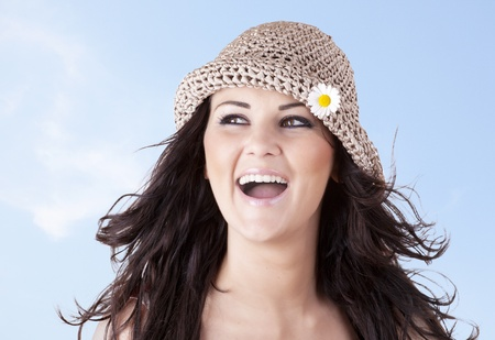 Girl with a smile and friendly expression on blue sky background Stock Photo - 8567575