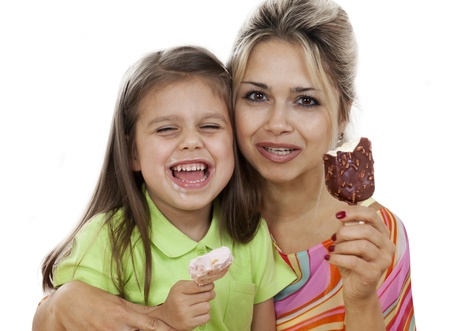 Mother And Daughter eating Ice Cream isolated on white photo