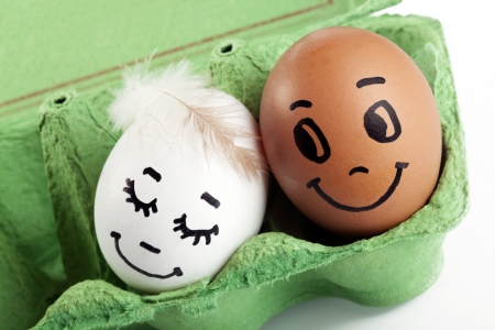 breakfast smiley face: Sweet couple egg staying close to each other with love Stock Photo