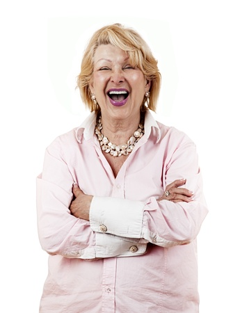 Portrait of a successful senior woman lauging with arms crossed isolated on white background  photo