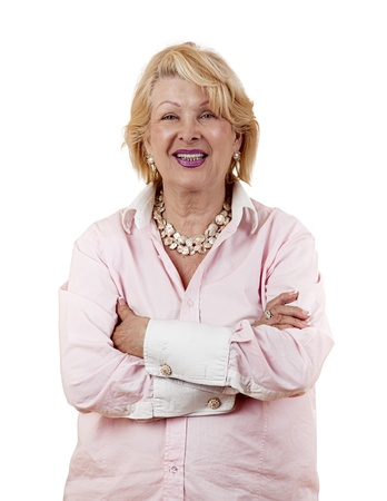 Portrait of a successful senior woman standing with arms crossed isolated on white background  photo