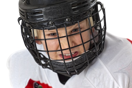 A young courageous hockey player with helmets look at the camera, isolated on white photo