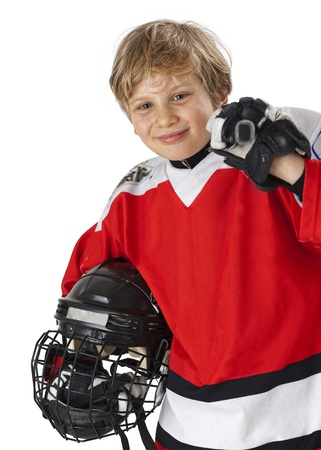 A young hockey player in uniform, isolated on white