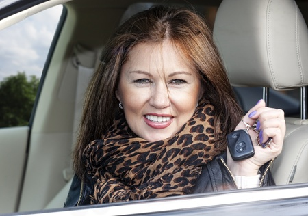 woman with keys of new , hire or rental car or just passed driving test photo