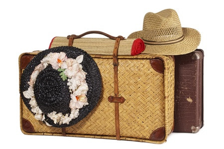 antique suitcases and antique Hat with Flower on white Background photo